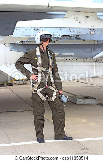military pilot in a helmet near the aircraft - csp11353514