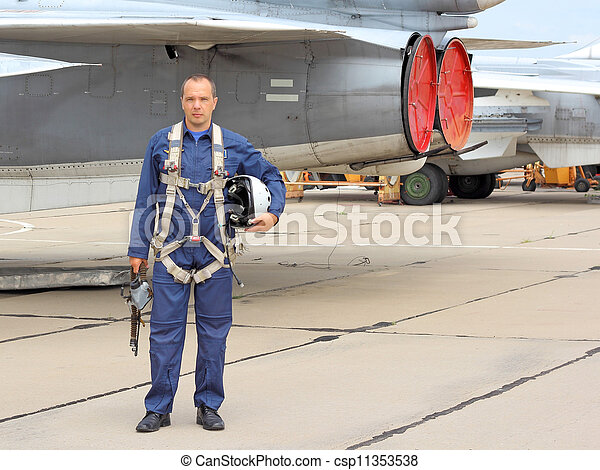 military pilot in a helmet near the aircraft - csp11353538