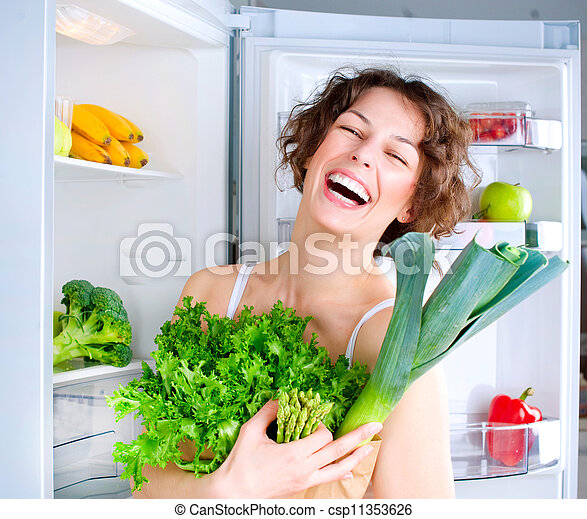 Beautiful Young Woman near the Refrigerator with healthy food - csp11353626