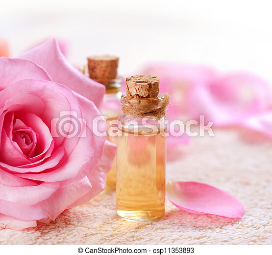Bottles of Essential Oil for Aromatherapy. Rose Spa  - csp11353893
