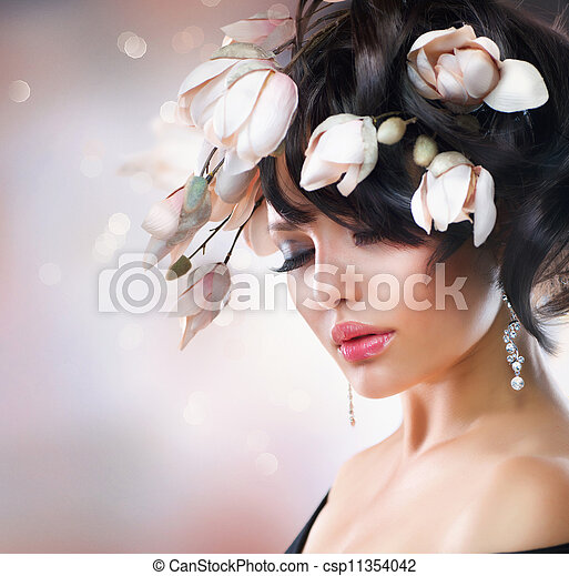 Fashion Brunette Girl with Magnolia Flowers. Hairstyle - csp11354042