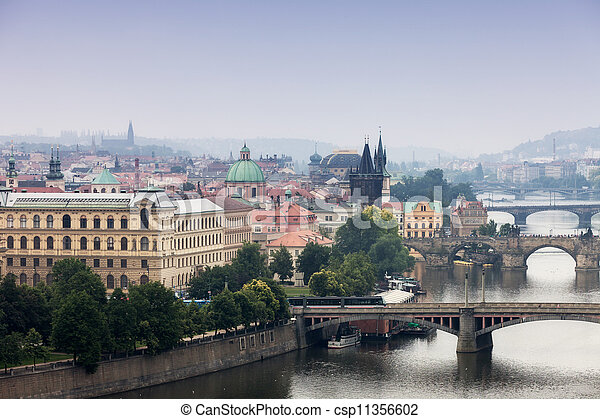 Prague, view of the Vltava River and bridges in a morning fog - csp11356602