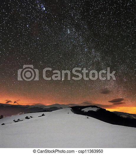 winter mountains under starry cloudy sky - csp11363950