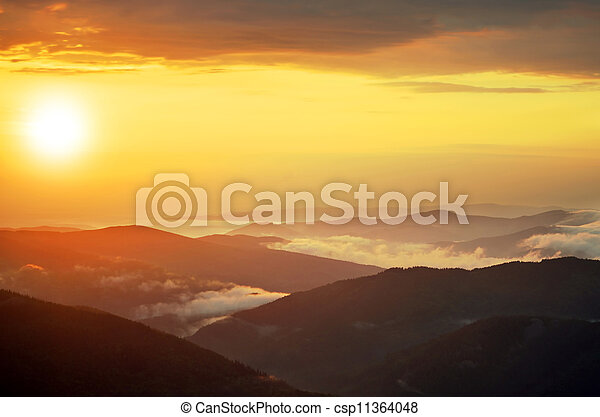 Spring landscape in mountains with the sun - csp11364048