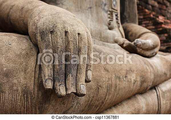 Buddha statue hand close up detail - csp11367881