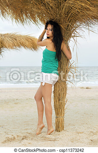 Beautiful young woman on a beach - csp11373242