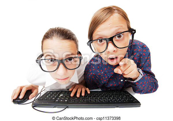 Young girls playing or working on a computer - csp11373398