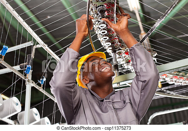 african american textile industrial mechanic - csp11375273