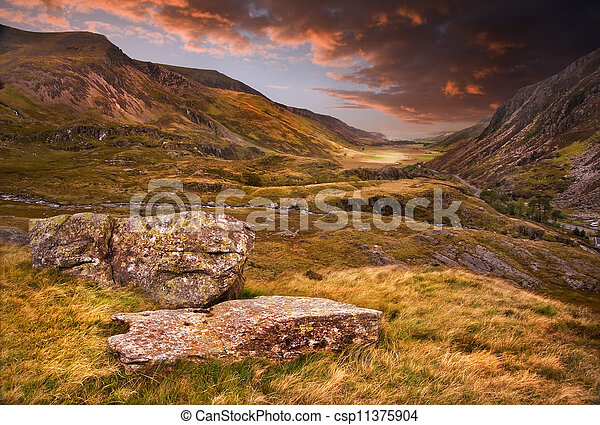 Moody dramatic mountain sunset landscape - csp11375904