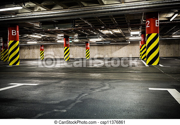 Parking garage in basement, underground interior - csp11376861