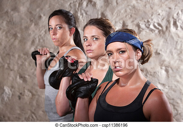 Ladies Lifting Weights in Boot Camp Workout - csp11386196