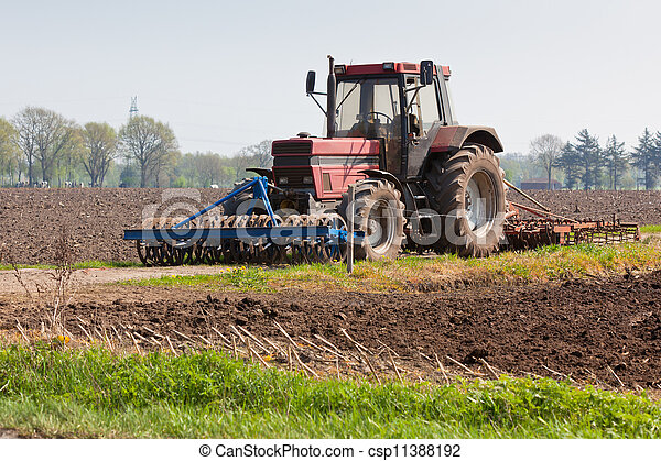 Agriculture - Tractor on the field - csp11388192