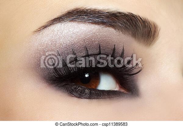Eye with black fashion make-up - csp11389583