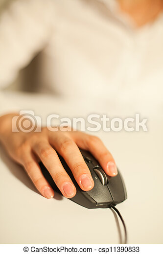 Hand with a computer mouse - csp11390833