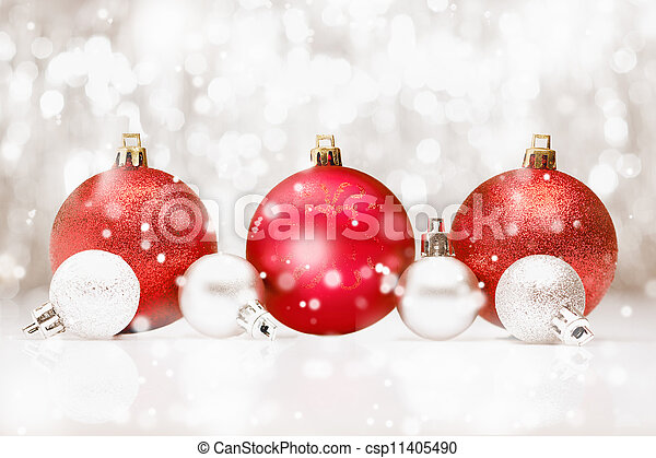 Christmas baubles in falling snow - csp11405490