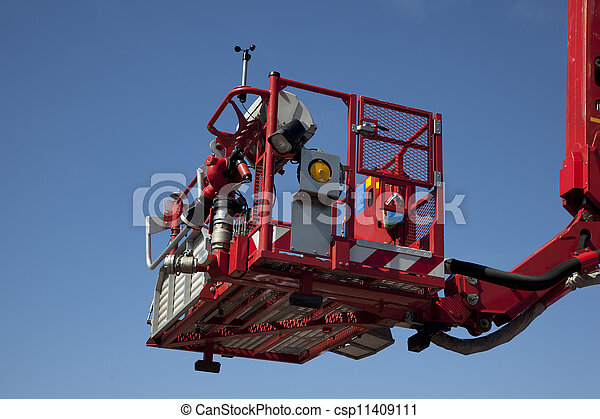 Articulated aerial hydraulic platform against a blue sky  - csp11409111
