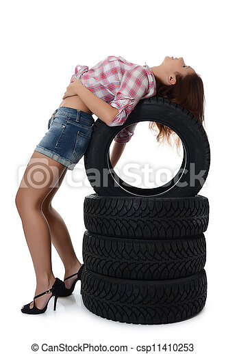 The girl with automobile tyres - csp11410253