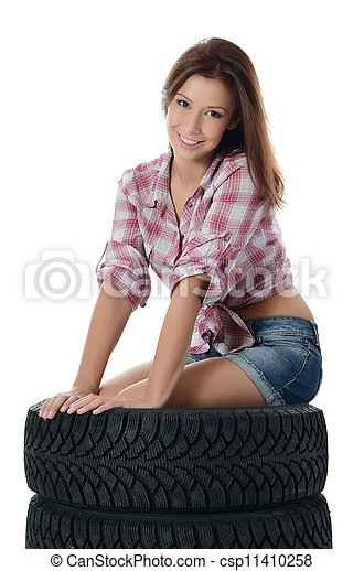 The girl with automobile tyres - csp11410258