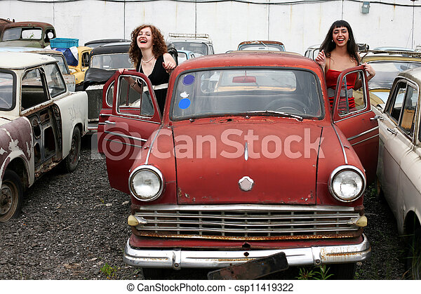 two girl with old car