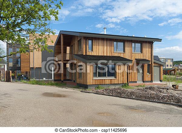 Stock fotografieken van moderne woning nieuw bouwen moderne houten woning csp11425696 for Afbeelding van moderne huizen