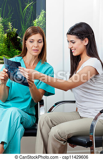 Dentist And Patient With Dental X-Ray - csp11429606