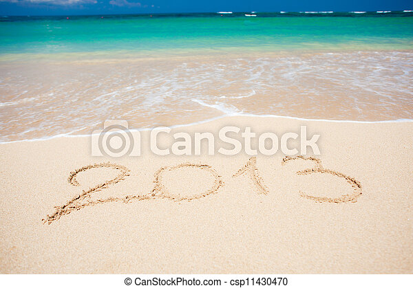 """New year background of beach with """"2013"""" handwritten in the sand, holiday christmas concept - csp11430470"""