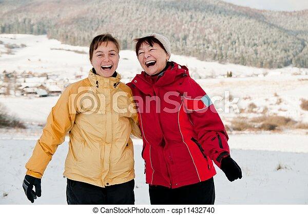 Happy retirement - mother and daughter in winter - csp11432740