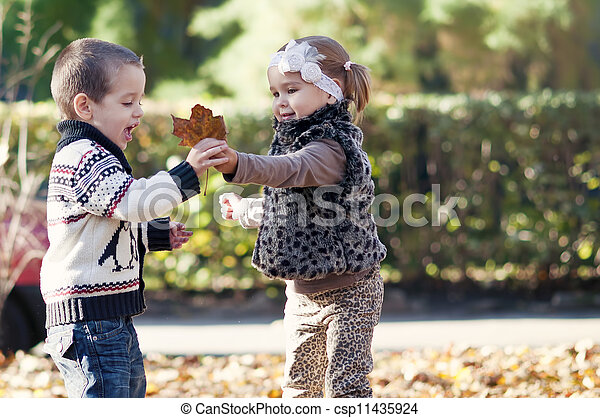 Kids playing in autumn park - csp11435924
