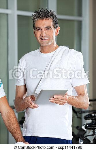 Man Using Digital Tablet In Health Club - csp11441790