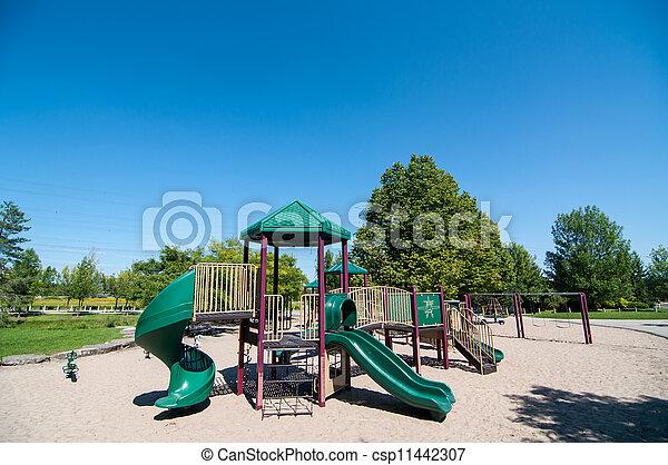 Playground Equipment in a Public Park - csp11442307