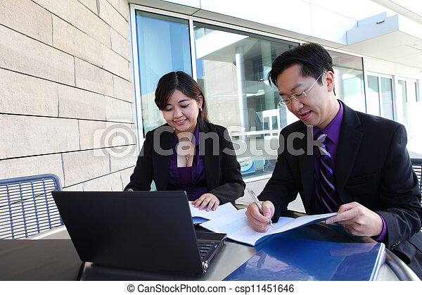 Chinese Man and Woman on Computer - csp11451646