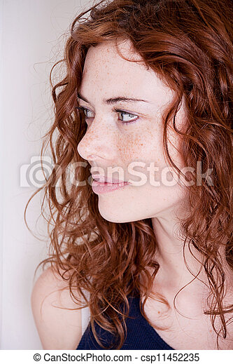 beautiful red head woman with freckle smiling - csp11452235