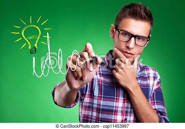 casual man wrtiting Idea and light bulb - csp11453997