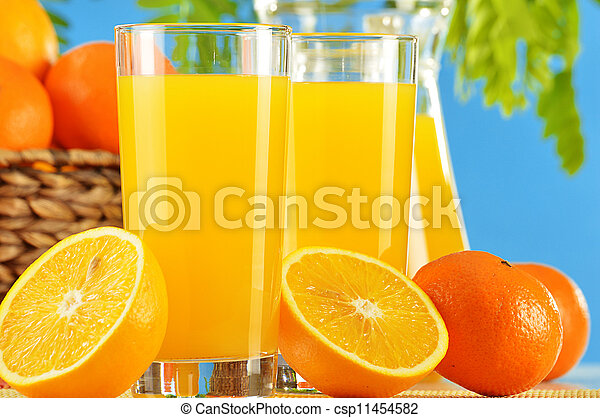 Composition with two glasses of orange juice and fruits - csp11454582