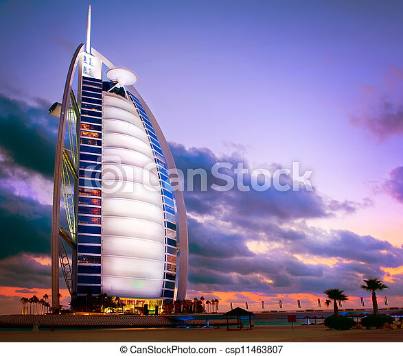 DUBAI, UAE - NOVEMBER 27: Burj Al Arab hotel on NOVEMBER 27, 2011 in Dubai. Burj Al Arab is a luxury 5 stars hotel built on an artificial island in front of Jumeirah beach. Sunset View - csp11463807