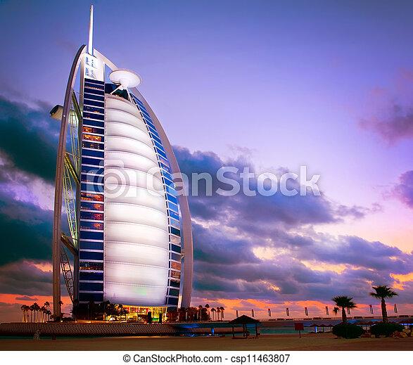 DUBAI, UAE - NOVEMBER 27: Burj Al Arab hotel on NOVEMBER 27, 2011 in Dubai. Burj Al Arab is a luxury 5 stars hotel built on an artificial island in front of Jumeirah beach. Sunset View - csp11463807