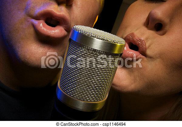 Couple Singing Duet - csp1146494