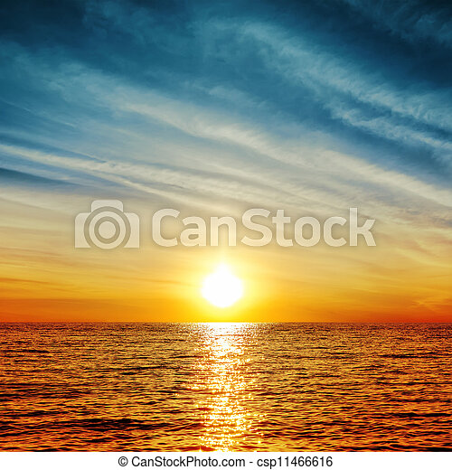 sunset over water - csp11466616