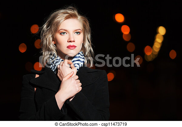 Young woman on the night city street - csp11473719