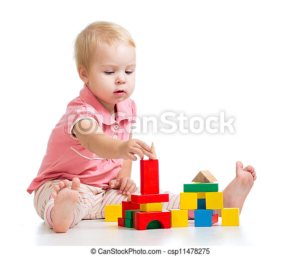 Child girl playing toy blocks and building tower. Isolated on white background - csp11478275