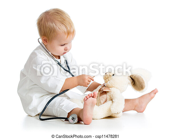 Adorable child dressed as doctor playing with toy over white - csp11478281