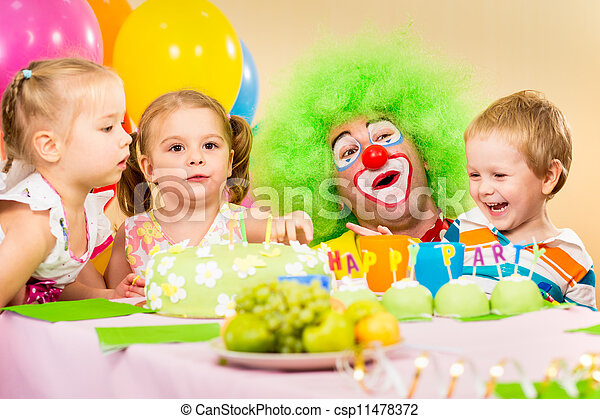 kids celebrating birthday party with clown - csp11478372