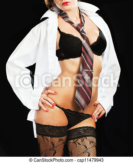 Sexy woman in erotic lingerie over dark background - csp11479943