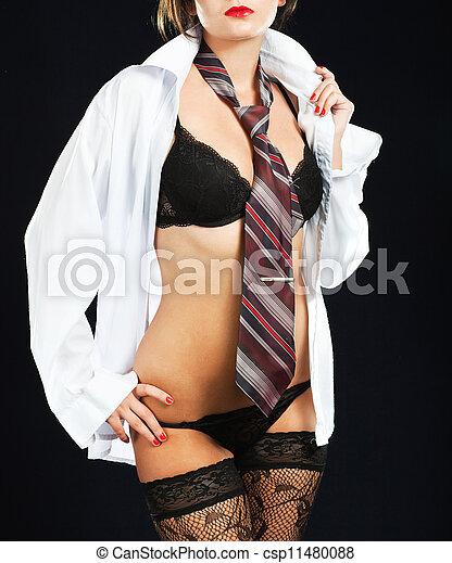 Sexy woman in erotic lingerie over dark background - csp11480088