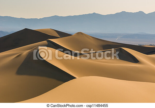 sand dunes over sunrise sky - csp11484455
