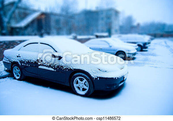 Snow-covered cars in the parking lot - csp11486572
