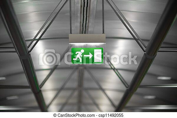 green emergency exit sign in public building - csp11492055