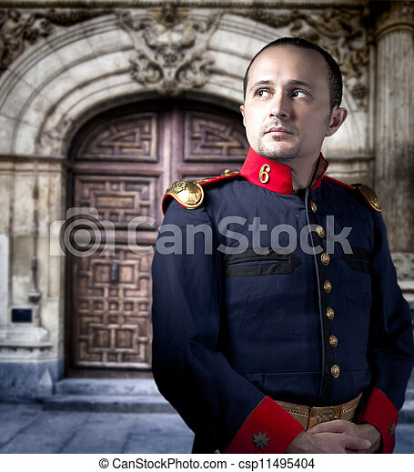 Antique soldier, man with military costume palace at background - csp11495404