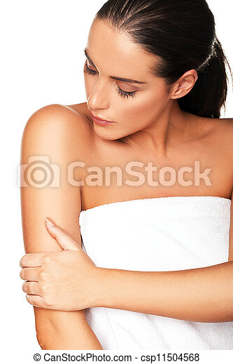 Beautiful woman caressing her arm - csp11504568