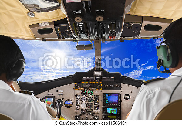 Pilots in the plane cockpit and sky - csp11506454
